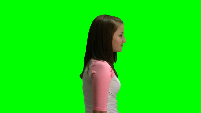 A young girl looking at something off screen. Chroma key/green screen background. - HD stock video clip