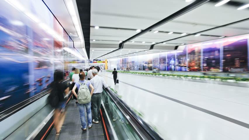 HONG KONG - CIRCA MAY 2011: Commuters on a moving walking transiting Hong Kong Central MTR Station - HD stock video clip