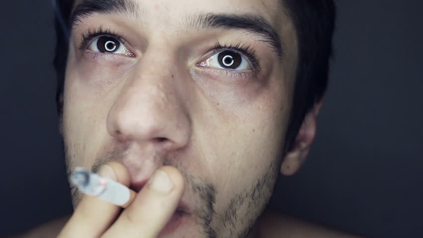 Young person emit smoke from mouth slow motion
