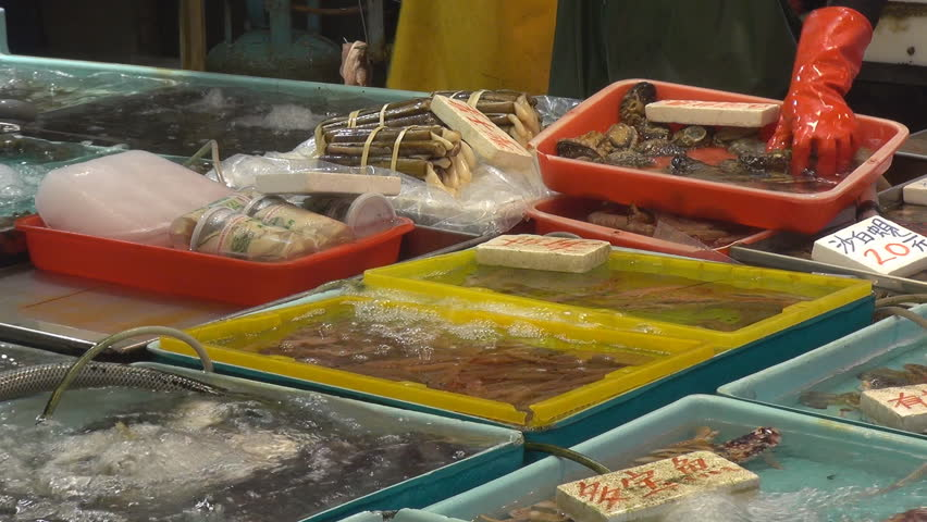 Fisherman sort fresh seafood for sale, street market, Hong Kong, China | Shutterstock HD Video #2586896