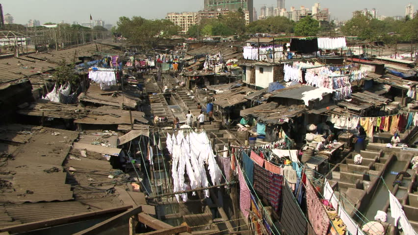 Mumbai, India - May 15, 2011: People washing laundry in a slum in India. Over 400 Million are classed as ultra poor in India. Poverty rates are higher than some East Asia countries such as Vietnam. - HD stock video clip