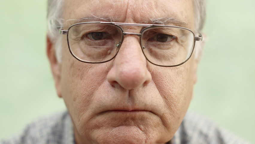 Old people and emotions, portrait of serious caucasian old man with glasses looking at camera - HD stock video clip