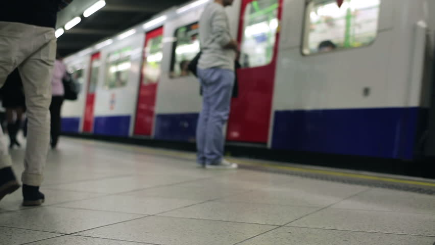 Subway train arrives at London metro station  - HD stock footage clip