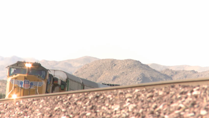 NEVADA, USA, FEB 29, 2012: Cargo train passing on railroad tracks through the
