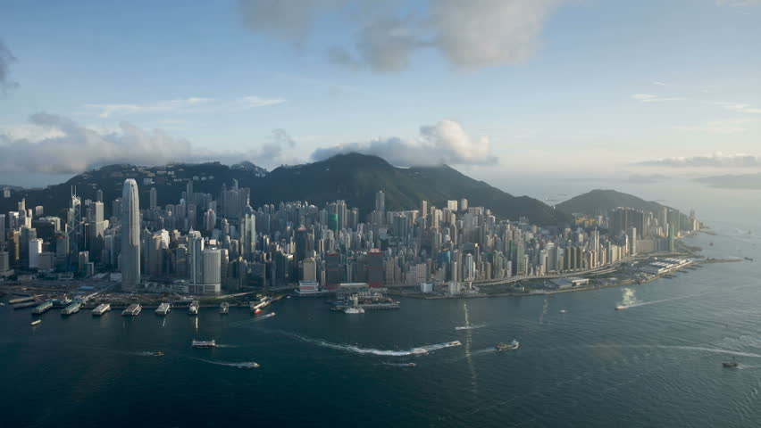 Aerial view over Hong Kong Island towards Victoria Peak showing the busy Victoria Harbour and Financial District | Shutterstock HD Video #2613500