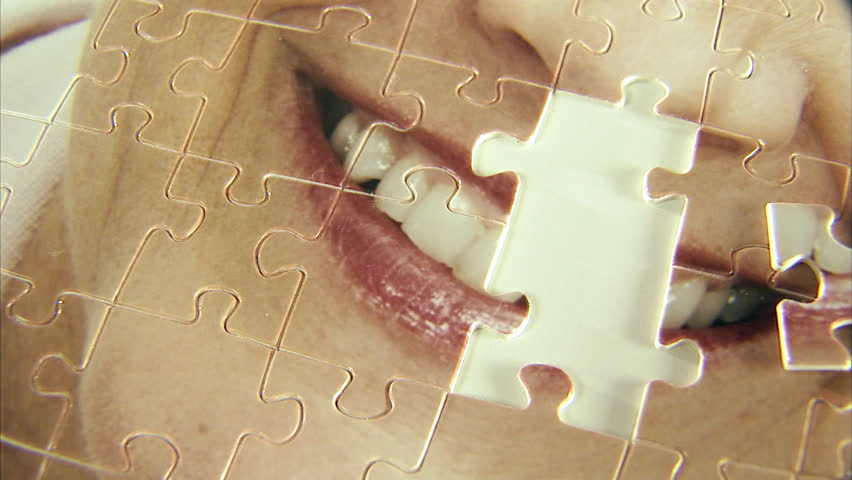 A puzzle with the image of a woman - HD stock video clip