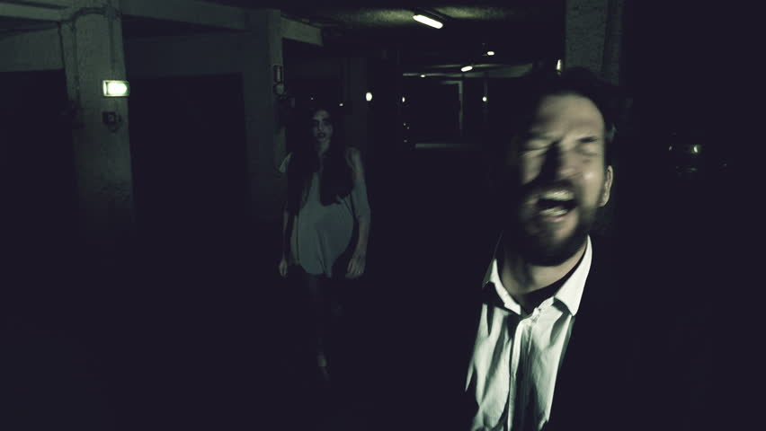 Female zombie watching man attacking angry wide shot | Shutterstock HD Video #26192303