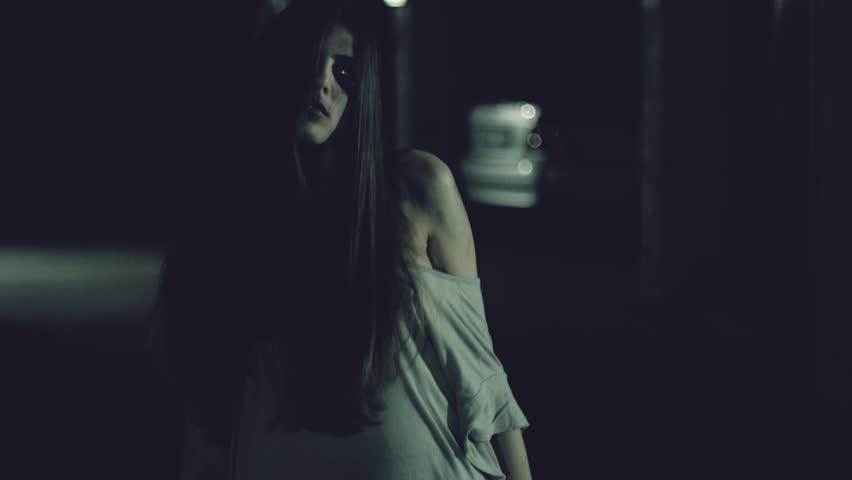 Female zombie chasing man slow motion | Shutterstock HD Video #26192312