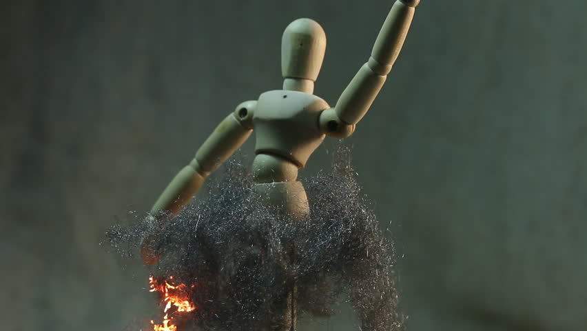 Abstract ballerina burning - A wooden mannequin spins like a ballerina in slow motion while fire travels throughout its steel wool tutu/skirt | Shutterstock HD Video #26214056
