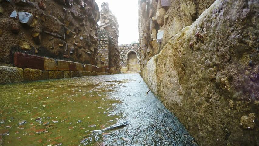4K video: Tourist man walking by the Qutb Minar ruines streets, New Delhi, India | Shutterstock HD Video #26217530