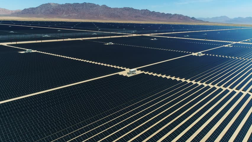 Sources of alternative energy / Huge fields of solar panels / the biggest solar farm in the world / Aerial Drone Shot / 4k Slow motion | Shutterstock HD Video #26219222
