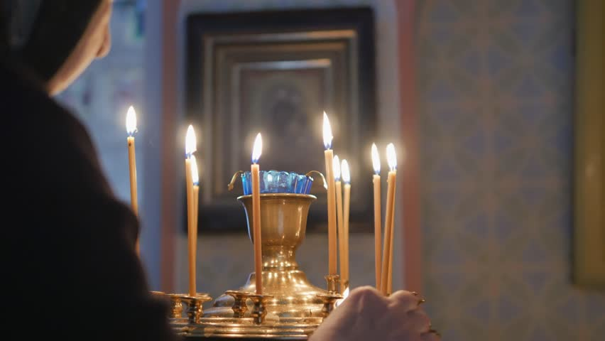 Burning candles on the altar | Shutterstock HD Video #26219762