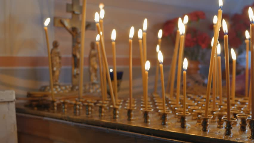 Burning candles on the altar | Shutterstock HD Video #26219771