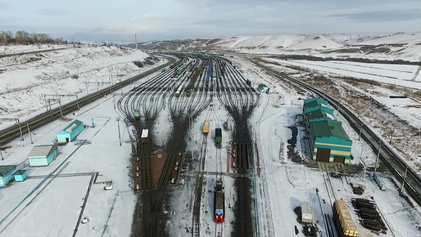 The railway station sorting of cars, Russia winter in Siberia, shooting from air | Shutterstock HD Video #26220770