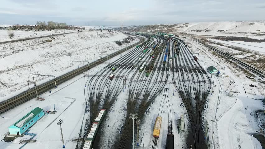 The railway station sorting of cars, Russia winter in Siberia, shooting from air | Shutterstock HD Video #26220797