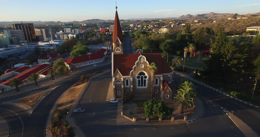 Aerial drone video with view of old historical fort in city center of Windhoek, other old buildings and church in town in central highland Khomas Hochland of Namibia, southern Africa | Shutterstock HD Video #26221472