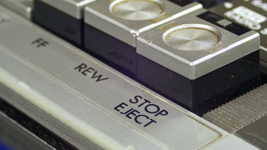 Pushing Pause Stop on a Vintage Tape Recorder. Close-up. Pushing a Finger Button Stop. Man finger presses playback control buttons on audio cassette player. | Shutterstock HD Video #26224019