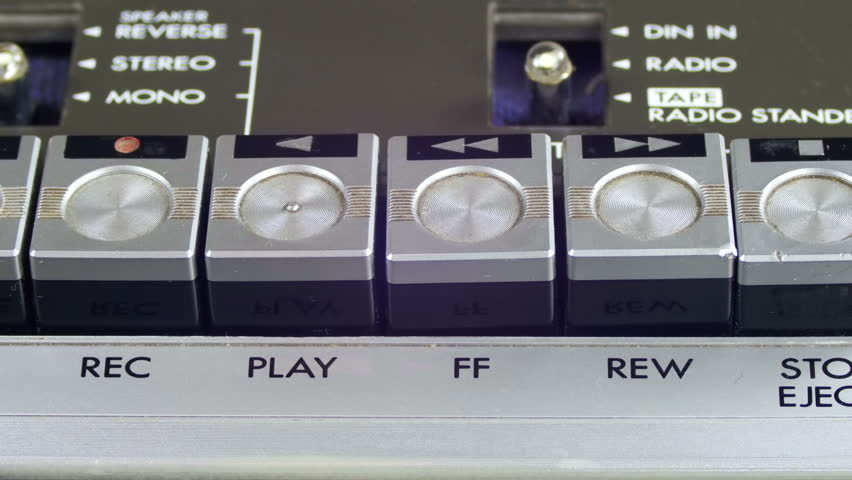 Pushing Play and Stop Button on a Vintage Tape Recorder. Close-up. Pushing Finger Buttons on Retro Player. Man finger presses playback control buttons on audio cassette player. | Shutterstock HD Video #26224028