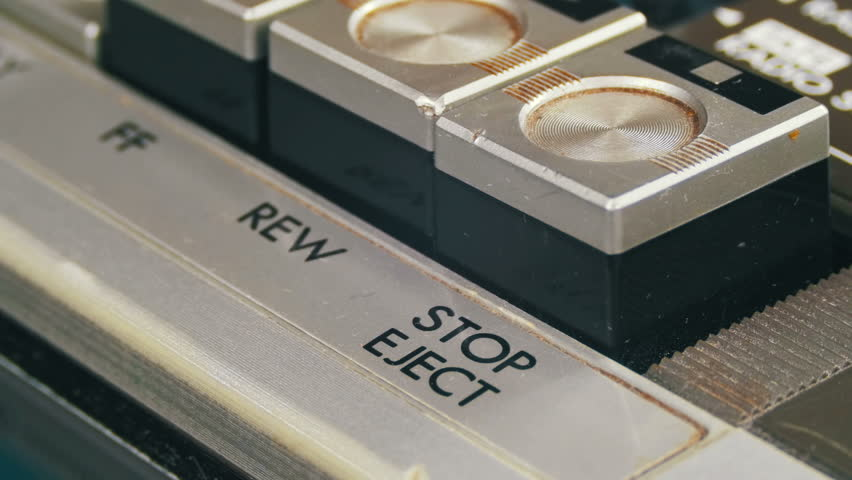 Pushing Stop Button on a Vintage Tape Recorder. Close-up. Pushing a Finger Button Stop. Man finger presses playback control buttons on audio cassette player. | Shutterstock HD Video #26224037