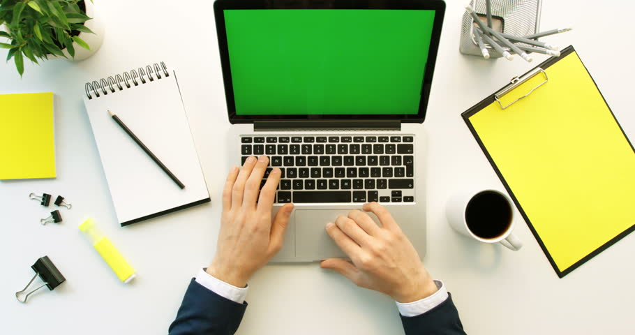 Business man working on laptop with green screen on office desk background. Man hands typing on laptop keyboard. Top view. Chroma key | Shutterstock HD Video #26225693