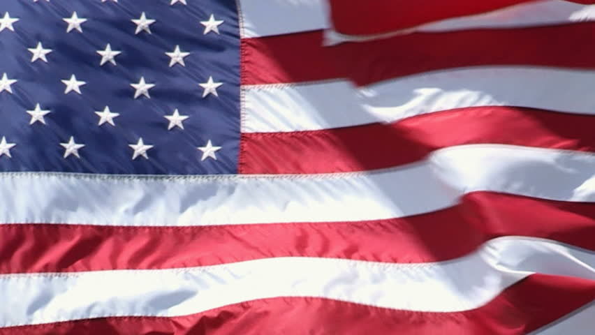 Tight view of a waving American flag. - HD stock footage clip