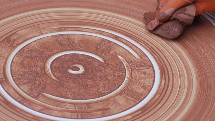 Potter paints clay on a potter's wheel | Shutterstock HD Video #26227493