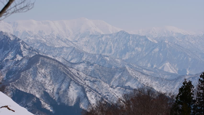 Timel apse pan view of Mountain peak covered in snow and clouds in Japan. Travel in Japan.  | Shutterstock HD Video #26227844
