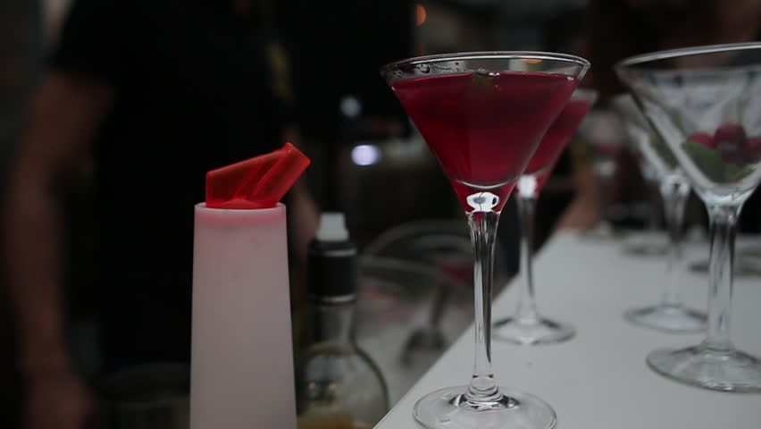 Cocktail into martini glass closeup shooting ride slow more | Shutterstock HD Video #26230580