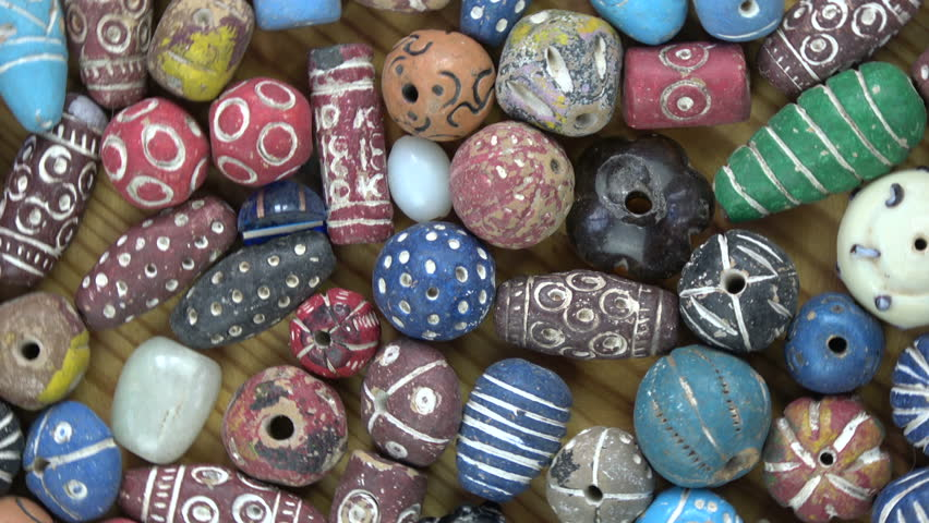 Rotating ancient vintage colorful decorated ceramic indian beads from Varanasi, video background   | Shutterstock HD Video #26230805