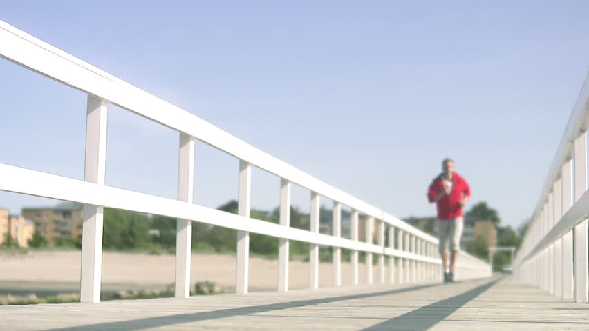 A man jogging on the beach - HD stock footage clip