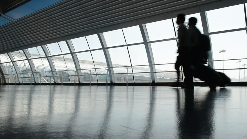 people walk through airport