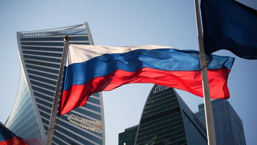 Close-up shot of flag of Russia in the wind on the background of Moscow City. HD #26426204