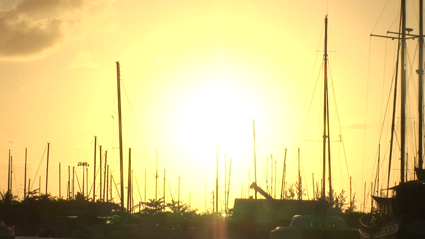 Golden sunset over a moorage in Saint Martin - HD stock footage clip