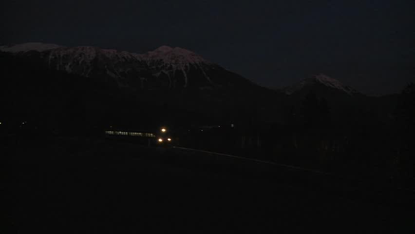 SWISS ALPS, SWITZERLAND-CIRCA 2011-A train passes in the dead of night.