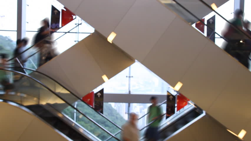 Shopping mall escalator - Time lapse of escalator stairs with crowds of blurred