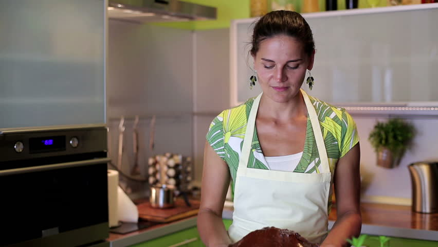 House wife presenting freshly baked chocolate cake  - HD stock footage clip