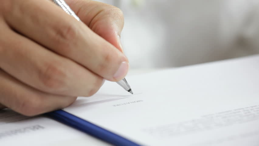Businessman signing a contract. Signature is fake