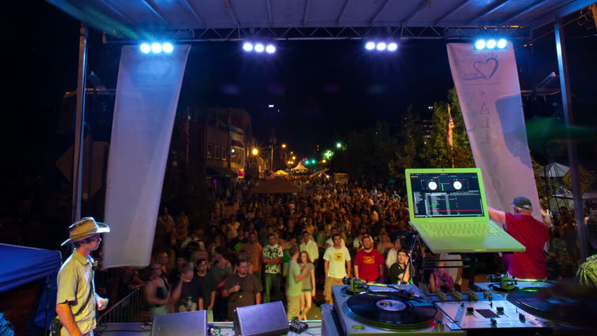 DJ rap music concert motion time-lapse on outdoor festival stage at night