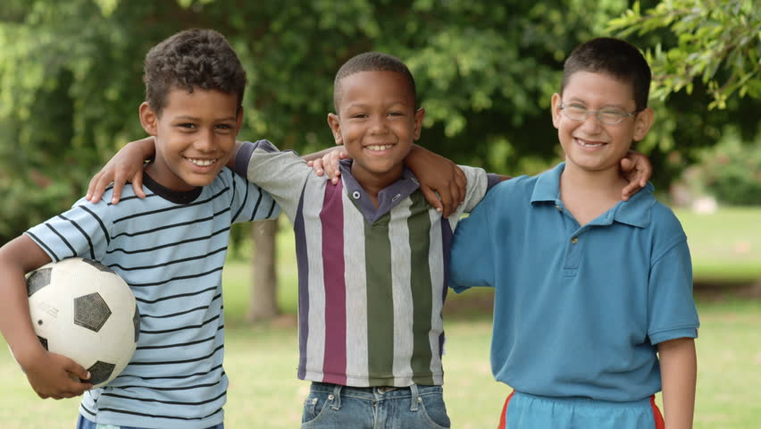 Young boys and sport, portrait of three happy young children with soccer ball smiling and looking at camera - HD stock video clip