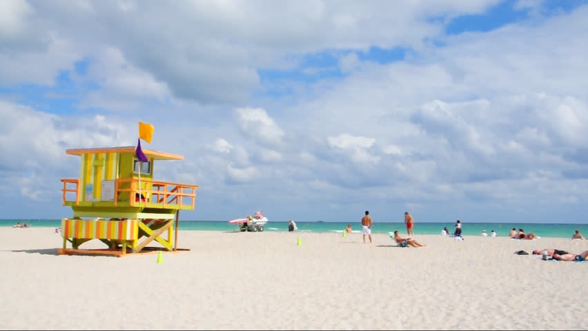 Lifeguard house on South Beach, Miami. Tourists playing games an relaxing on a sunny day
