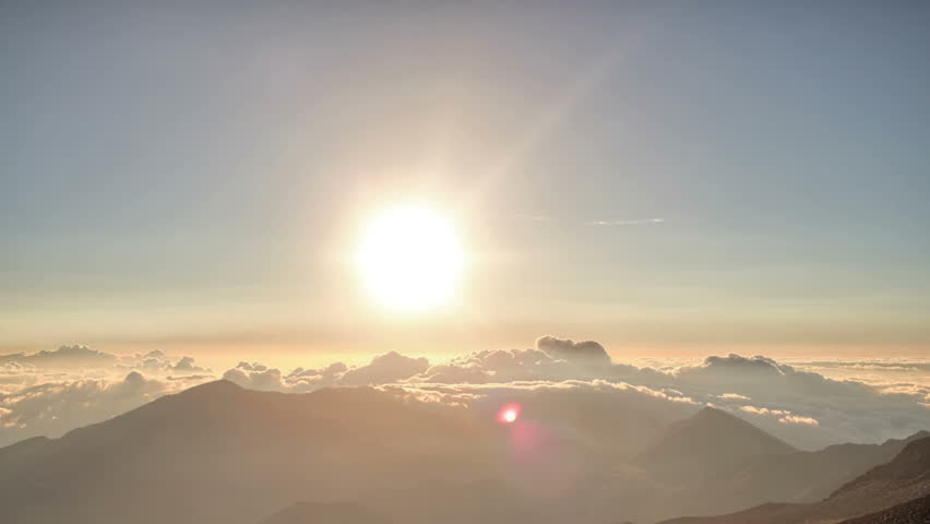 Brilliant summit dawn above flowing cloud waves, red sun disk time lapse in HDR  - HD stock footage clip
