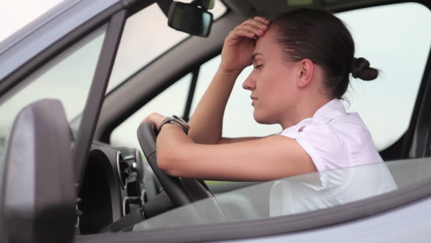 Sad businesswoman sitting in the car