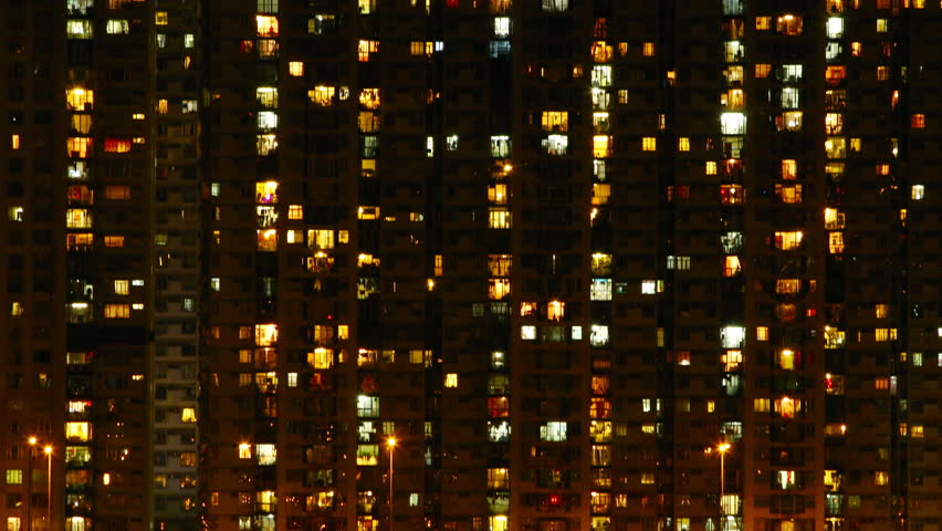 High-density apartment block at night, Hong Kong. ( Time lapse )
