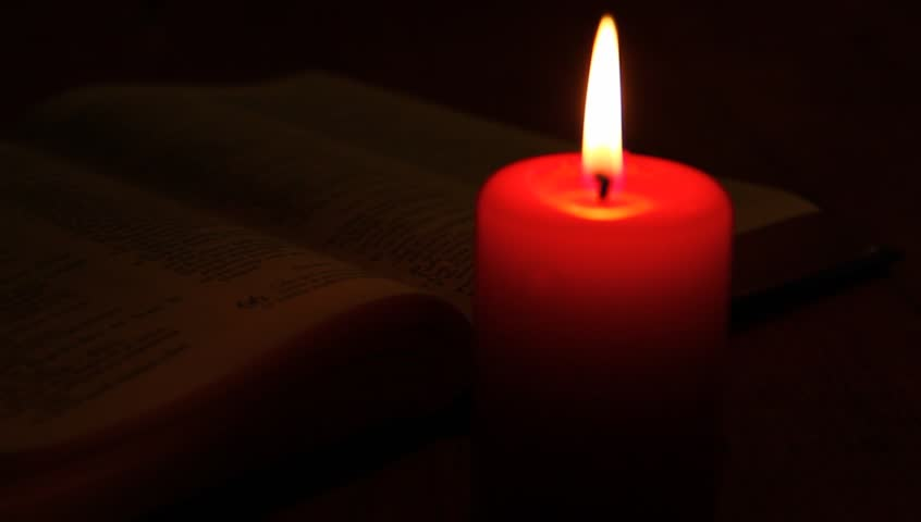 Hand turning pages and red candle. | Shutterstock HD Video #2777624