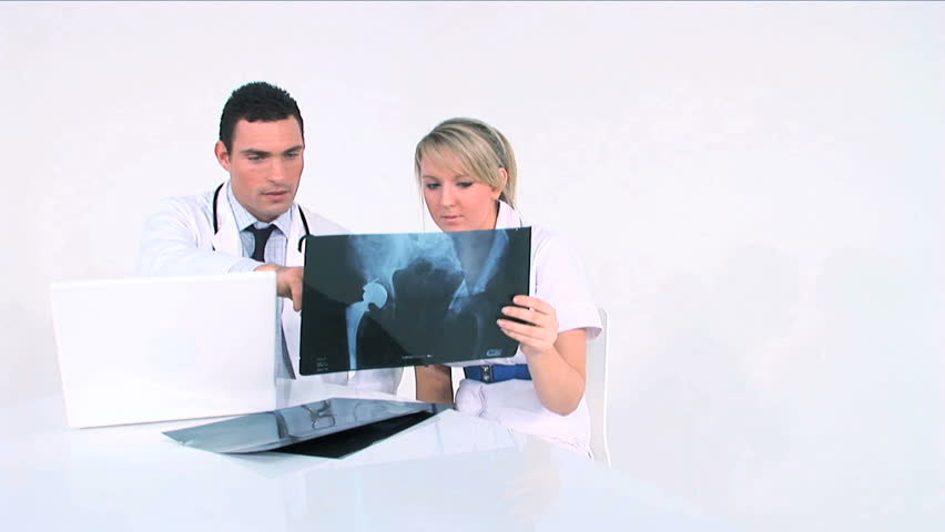 Young medical staff examining medical records - HD stock footage clip
