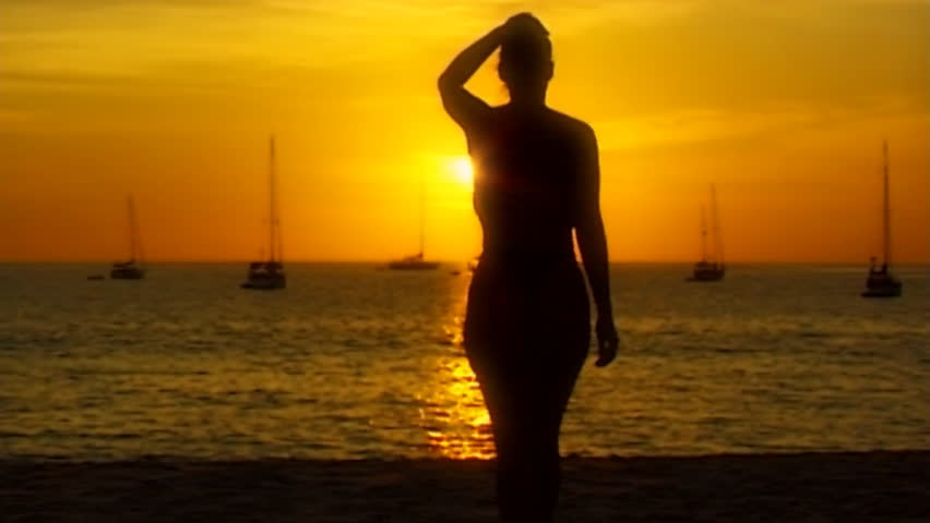 topless woman beach sundown 01soft in slow motion - slightly soft