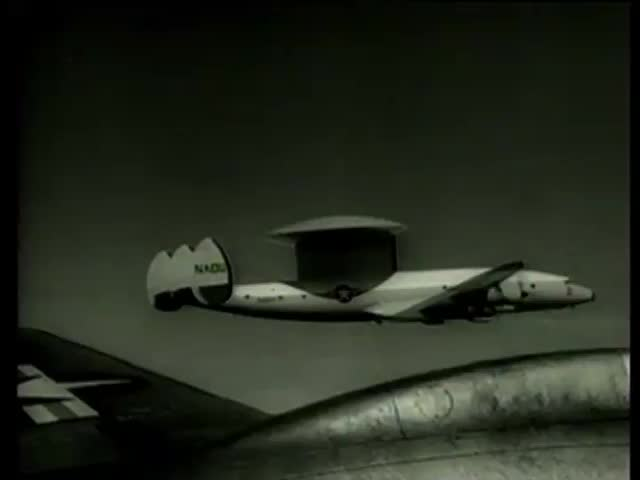 A view from another airplane of the airplane with a new distance detection radar antenna disc in sky Massachusetts circa 1958-MGM PICTURES, UNIVERSAL-INTERNATIONAL NEWSREEL, USA, filmed in 1958 - SD stock footage clip
