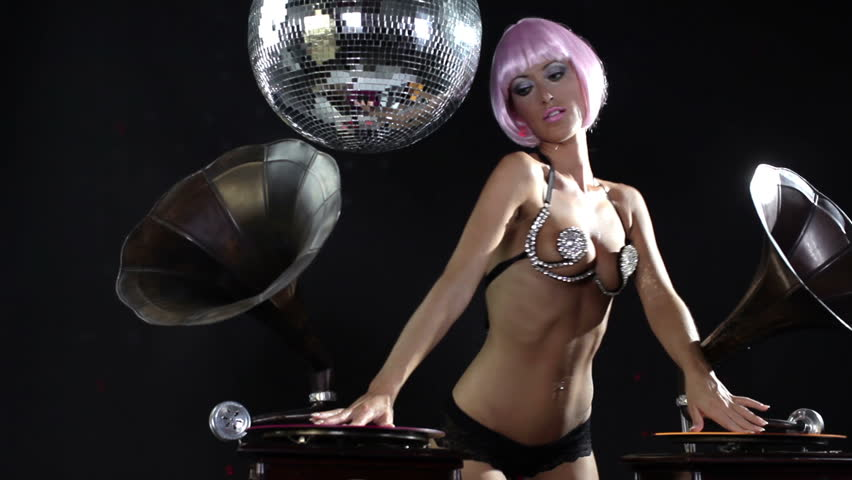 sexy professional dancer with pink hair spinning records