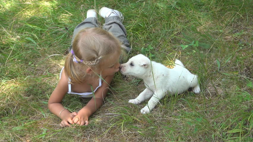 Child Kissing her Puppy, Child Playing with her Little Dog