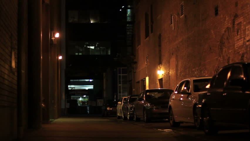 A typical alley in downtown Calgary.  Lighting makes it look very sinister.  Perhaps the site of a crime scene.  Great for establishing a dark mood in the city.